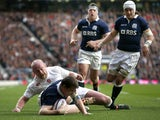 Mark Bennett of Scotland dives over the line to score a try under pressure from Dan Cole of England during the RBS Six Nations match between England and Scotland at Twickenham Stadium on March 14, 2015