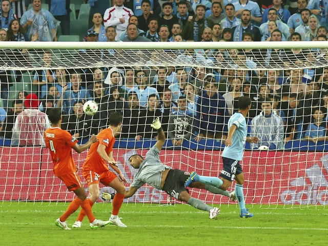 Alex Brosque of Sydney FC scores his teams fifth goal during the round 21 A-League match between Sydney FC and Brisbane Roar at Allianz Stadium on March 15, 2015