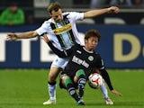 Moenchengladbach's defender Tony Jantschke (L) and Hanover's Japanese midfielder Hiroshi Kiyotake vie for the ball during the German first division Bundesliga football match