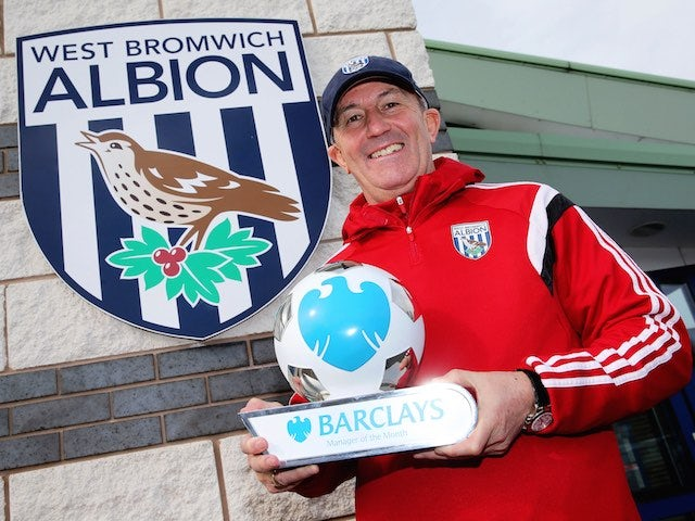 Tony Pulis with the manager of the month award for February 2015