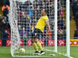 Troy Deeney of Watford celebrates Watford's first goal during the Sky Bet Championship match between Watford and Reading at Vicarage Road on March 14, 2015