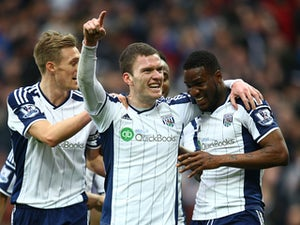 Brown Ideye of West Brom celebrates scoring the opening goal with team mates Darren Fletcher of West Brom and Craig Gardner of West Brom (C) during the Barclays Premier League match between West Bromwich Albion and Stoke City at The Hawthorns on March 14,
