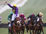 Davy Russell celebrates victory riding Windsor Park in the Neptune Investment Management Novices' Hurdle race during day two of the Cheltenham Festival at Cheltenham Racecourse on March 11, 2015