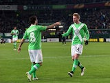 Wolfsburg's Belgian midfielder Kevin De Bruyne celebrates after scoring his team's second goal with Wolfsburg's Portuguese striker Vieirinha during the UEFA Europa League first-leg, Round of 16 football match VfL Wolfsburg vs FC Internazionale Milano in W