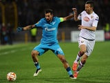 Zenit's Portuguese midfielder Miguel Danny vies for the ball with Torino's Moroccan midfielder Omar El Kaddouri during the UEFA Europa League round of 16 football match between FC Zenit and FC Torino in Saint Petersburg on March 12, 2015
