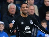 Everton's English midfielder Aaron Lennon (L) celebrates scoring the second goal for his team during the English Premier League football match against Queens Park Rangers on March 22, 2015
