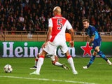 Aaron Ramsey of Arsenal (R) scores their second goal during the UEFA Champions League round of 16 second leg match between AS Monaco and Arsenal at Stade Louis II on March 17, 2015