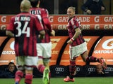 AC Milan's defender from France Philippe Mexes celebrates after scoring during the Italian Serie A football match AC Milan vs Cagliari on March 21, 2015