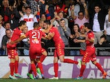 Dylan McGowan of United celebrates with his team mates after scoring during the round 22 A-League match between Adelaide United and Melbourne Victory at Coopers Stadium on March 21, 2015