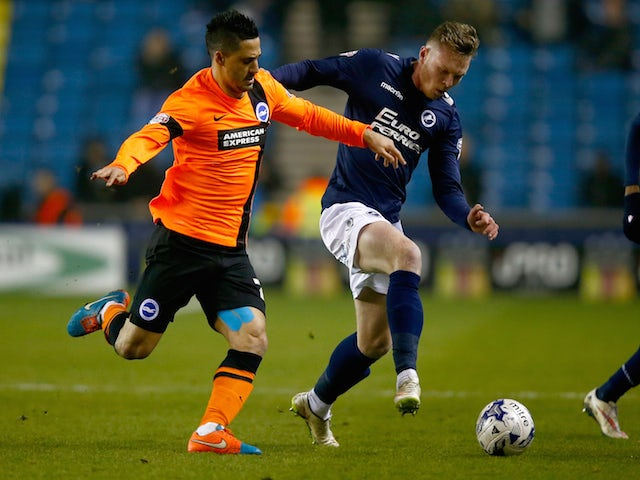 Aiden O'Brien of Millwall is challanged by Beram Kayal of Brighton & Hove Albion during the Sky Bet Championship match on March 17, 2015