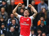Olivier Giroud of Arsenal celebrates scoring his opening goal during the Barclays Premier League match between Newcastle United and Arsenal at St James' Park on March 21, 2015