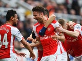 Olivier Giroud of Arsenal celebrates scoring his second goal with Francis Coquelin during the Barclays Premier League match between Newcastle United and Arsenal at St James' Park on March 21, 2015