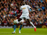 Jores Okore of Aston Villa and Bafetibis Gomis of Swansea City compete for the ball during the Barclays Premier League match between Aston Villa and Swansea City at Villa Park on March 21, 2015