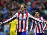 Atletico Madrid's forward Fernando Torres celebrates after scoring a goal during the Spanish league football match Club Atletico de Madrid vs Getafe CF at the Vicente Calderon stadium in Madrid on March 21, 2015