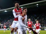 Markus Henriksen of AZ celebrates scoring the winning goal in the final minute of the game as Steven Berghuis jumps on his back during the Dutch Eredivisie match between AZ Alkmaar and SC Cambuur held at the AFAS Stadion on March 21, 2015