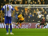 Bakary Sako of Wolves opens the scoring from the penalty spot during the Sky Bet Championship match against Sheffield Wednesday on March 17, 2015