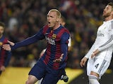 Barcelona's French defender Jeremy Mathieu celebrates after scoring a goal next to Real Madrid's defender Sergio Ramos during the 'clasico' Spanish league football match FC Barcelona vs Real Madrid CF at the Camp Nou stadium in Barcelona on March 22, 2015