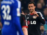 Leverkusen's forward Karim Bellarabi celebrates during the German first division Bundesliga football match FC Schalke 04 vs Bayer Leverkusen in Gelsenkirchen, western Germany, on March 21, 2015