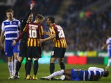 Referee Mike Jones shows the red card to Filipe Morais of Bradford City during the FA Cup Quarter Final Replay match between Reading and Bradford City at Madejski Stadium on March 16, 2015
