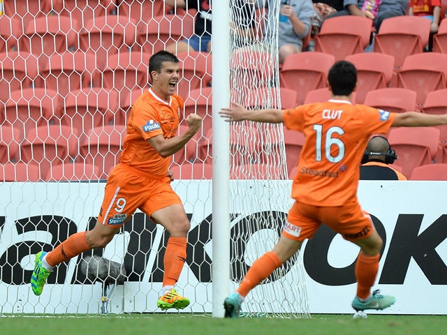 Andrija Kaluderovic of the Roar celebrates after scoring a goal during the round 22 A-League match between the Brisbane Roar and the Wellington Phoenix at Suncorp Stadium on March 22, 2015