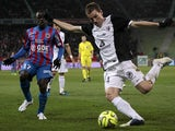 Caen's French midfielder N'golo Kante vies for the ball with Metz's French defender Gaetan Bussmann during the French L1 football match between Caen and Metz on March 21, 2015