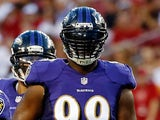 Defensive end Chris Canty #99 of the Baltimore Ravens lines up against the Tampa Bay Buccaneers during a preseason game at Raymond James Stadium on August 8, 2013