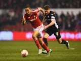 Dexter Blackstock of Nottingham Forest is chased by Lee Frecklington of Rotherham United during the Sky Bet Championship match on March 18, 2015