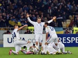 Players of FC Dynamo Kiev celebrate after scoring during the UEFA Europa League round of 16 football match between Dynamo Kiev and Everton in Kiev on March 19, 2015