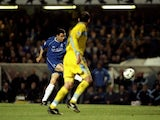 Gustavo Poyet of Chelsea scores the opening goal during the UEFA Champions League game between Chelsea and Lazio at Stamford Bridge in London March 22, 2000