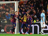 Ivan Rakitic of Barcelona (L) celebrates scoring the opening goal with Neymar and Luis Suarez of Barcelona during the UEFA Champions League Round of 16 second leg match against Manchester City on March 18, 2015