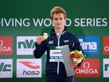 Jack Laugher poses with his gold medal after winning the men's 3m in Dubai on March 20, 2015