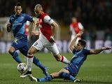 Monaco's French defender Layvin Kurzawa (C) is tackled by Arsenal's Chilean striker Alexis Sanchez (R) during the UEFA Champions League football match Monaco vs Arsenal, on March 17, 2015