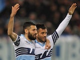 Felipe Anderson with his teammate Antonio Candreva (L) of SS Lazio celebrates after scoring the opening goal during the Serie A match between SS Lazio and Hellas Verona FC at Stadio Olimpico on March 22, 2015