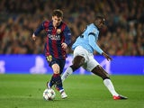 Lionel Messi of Barcelona is challenged by Yaya Toure of Manchester City during the UEFA Champions League Round of 16 second leg match on March 18, 2015