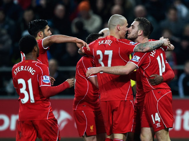 Jordan Henderson of Liverpool celebrates the opening goal with team mates during the Barclays Premier League match between Swansea City and Liverpool at Liberty Stadium on March 16, 2015