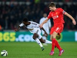 Liverpool player Steven Gerrard challenges Nathan Dyer of Swansea during the Barclays Premiership match between Swansea City and Liverpool at Liberty Stadium on March 16, 2015