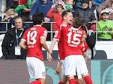 Mainz' defender Niko Bungert celebrates with teammates scoring during the German first division Bundesliga football match FSV Mainz 05 vs VfL Wolfsburg in Mainz, central Germany, on March 22, 2015