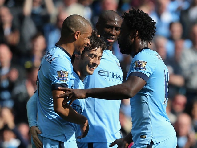 David Silva of Manchester City celebrates scoring their third goal with team mates during the Barclays Premier League match between Manchester City and West Bromwich Albion at Etihad Stadium on March 21, 2015