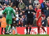 Referee Martin Atkinson separates Manchester United's Spanish goalkeeper David de Gea and Liverpool's Slovakian defender Martin Skrtel during the English Premier League football match between Liverpool and Manchester United at Anfield in Liverpool, north