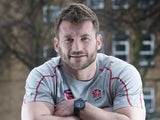 Mark Cueto leans on a rugby ball