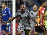 Marseille's Ghanaian forward Andre Ayew celebrates after scoring a goal during the French L1 football match between Lens and Marseille on March 22, 2014