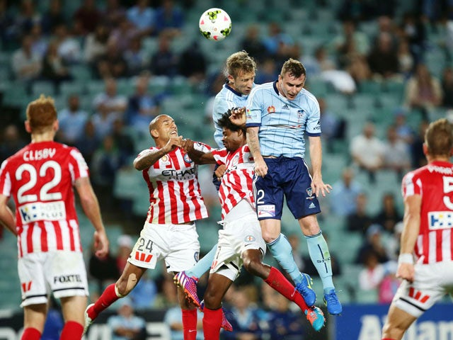 Marc Janko and Sebastian Ryall of Sydney FC are challenged Patrick Kisnorbo (L) and Kew Jaliens (R) of Melbourne City during the round 22 A-League match between Sydney FC and Melbourne City FC at Allianz Stadium on March 20, 2015