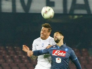 Atalanta's Italian forward Rolando Bianchi (L) fights for the ball with Napoli's Uruguayan defender Miguel Angel Britos during the Italian Serie A football match SSC Napoli vs Atalanta BC on March 22, 2015