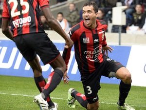 Ten-man Nice record shock win at Lyon