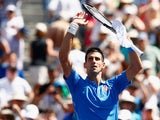 Novak Djokovic of Serbia celebrates defeating Andy Murray of Great Britain during day thirteen of the BNP Paribas Open tennis at the Indian Wells Tennis Garden on March 21, 2015