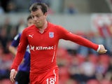 Paul McGowan of Dundee during the Pre Season Friendly match between Morecambe and Dundee at the Globe Arena on July 19, 2014