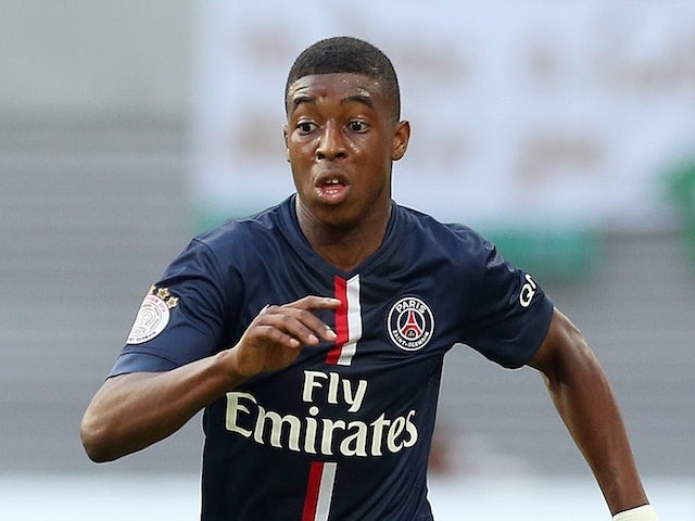 Paris Saint-Germain's defender Presnel Kimpembe runs with the ball during a friendly football match between German second division team RB Leipzig  on July 16, 2014