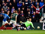 Rangers forward Kenny Miller slots the ball past Hibs goalkeeper Mark Oxley for the second goal during the Scottish Championship match between Hibernian and Rangers at Easter Road on March 22, 2015