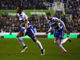 Garath McCleary of Reading celebrates scoring his team's second goal during the FA Cup Quarter Final Replay match between Reading and Bradford City at Madejski Stadium on March 16, 2015