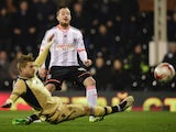 Ross McCormack of Fulham shoots past Gaetano Berardi of Leeds United during the Sky Bet Championship match between Fulham and Leeds United at Craven Cottage on March 18, 2015
